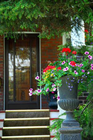 House entrance with flower vase