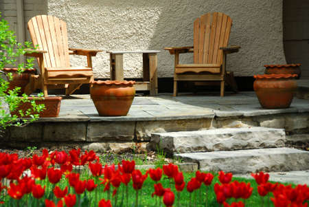House patio with wooden chairs photo