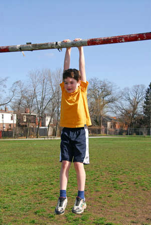 Little boy hanging on the soccer gate Stock Photo - 410886