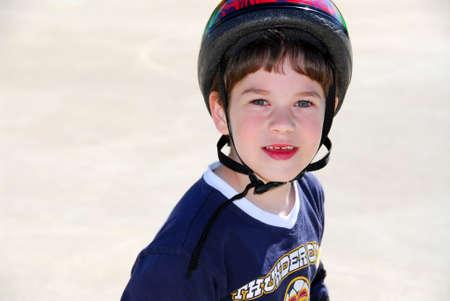 rollerblading: Portrait of a little boy rollerblading in a helmet