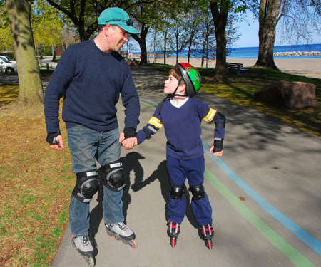 rollerblade: Father and son rollerblading Stock Photo