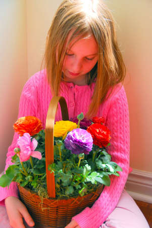 Portrait of a girl with flower basket Stock Photo - 419049