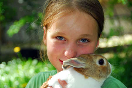 Young girl holding a bunny photo