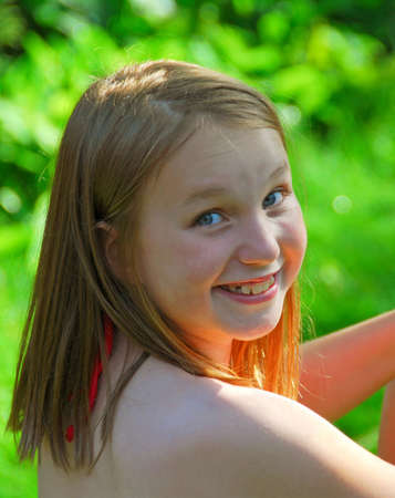 pool preteen: Portrait of a smiling young girl in summer Stock Photo