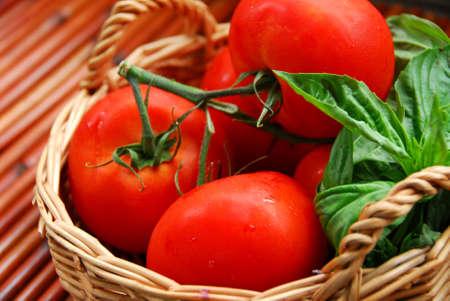 tomatos: Tomatos and basil in a basket