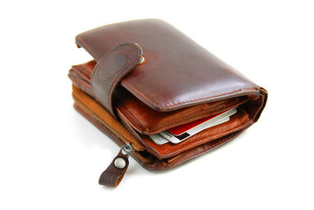 Old leather wallet full of credit cards on white background Banco de Imagens