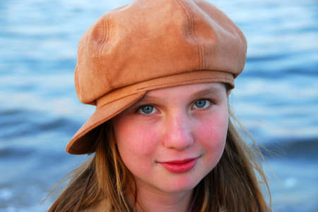 suede: Portrait of a cute girl in suede hat