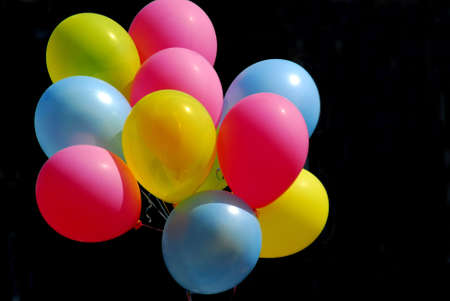 Colorful balloons on black background photo