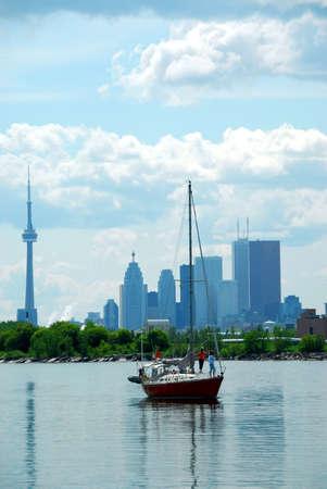 highrises: Toronto city skyline with a sailboat