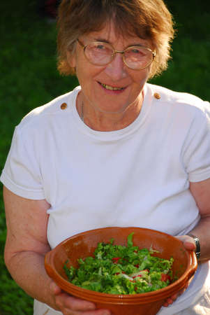 Happy senior woman with bowl of salad in her hands Stock Photo - 428710