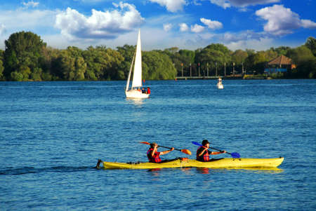 Fast moving kayak on a lake photo