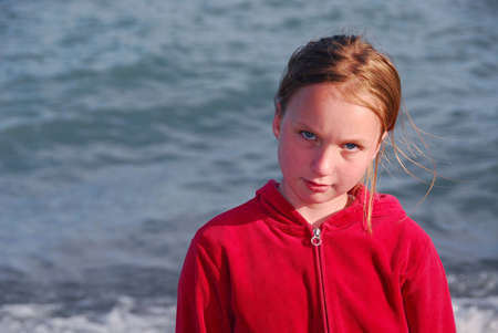 pouty: Portrait of a beautiful young girl on sea water background