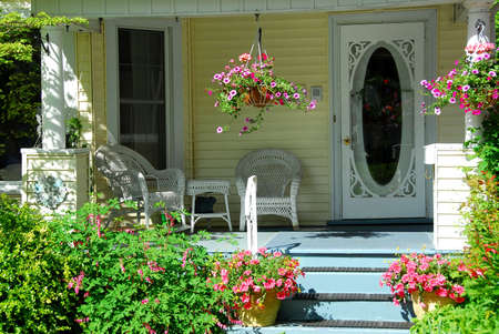 front of house: House porch with wicker furniture and flowers