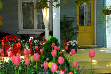 front door: House porch with wicker furniture and flowers