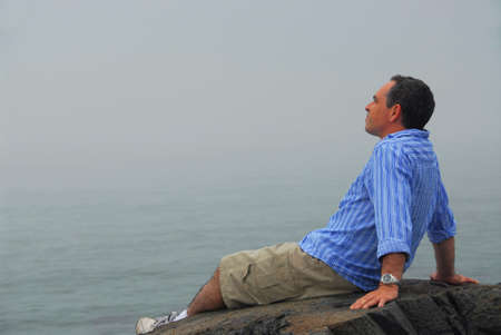 Man looking at the foggy ocean. Uncertain future concept. Stock Photo - 458188