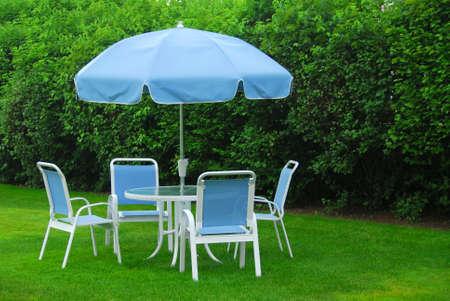 Patio furniture on green lawn photo