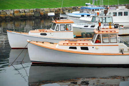 Fishing boats in a harbor in Perkins Cove, Maine photo