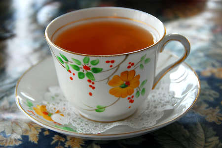 Tea in a cup with saucer, shallow dof Stock Photo