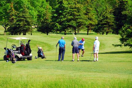 Active senior men on golf course