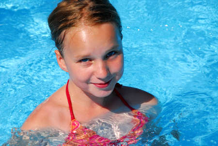 wet suit: Young girl in a swimming pool Stock Photo