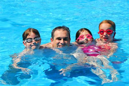 スイミング プールで幸せな家族 写真素材