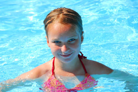 Young girl in a swimming pool Stock Photo