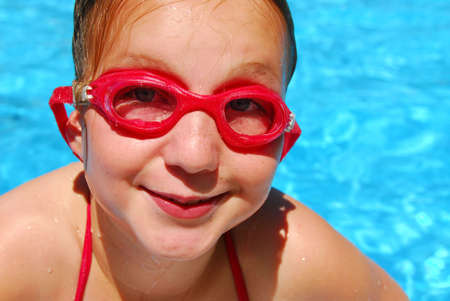 pool preteen: Portrait of a smiling girl in red goggles