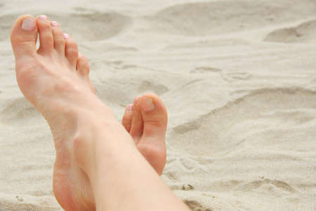 painted toes: Womans feet on a sandy beach