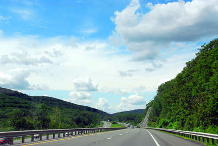 divided: Divided highway among green rolling hills Stock Photo