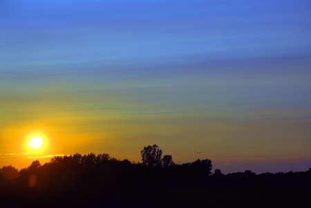the setting sun: Setting sun in a countryside Stock Photo