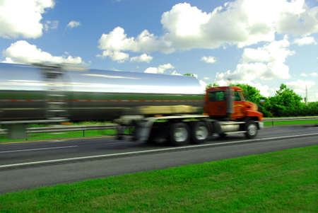 zooming: Speeding truck delivering gasoline on highway