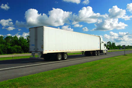 moving truck: Fast moving truck with white container on highway, blurred because of motion