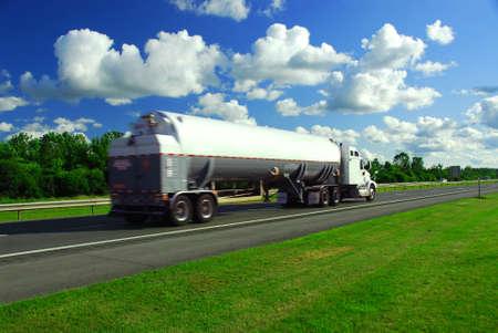 Speeding truck delivering gasoline on highway blurred because of motion Banco de Imagens