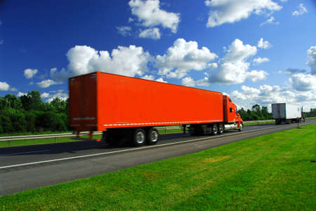 moving truck: Bright red truck on road, blurred because of fast motion