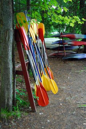 paddles: Kayak paddles and kayaks at camp