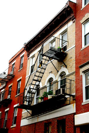 Row of brick houses in Boston historical North End metal fire escapes photo