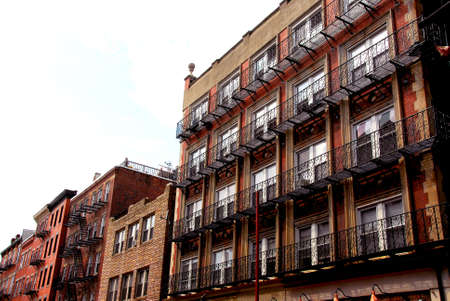 Row of brick houses in Boston historical North End with wrought iron balconies and fire escapes photo