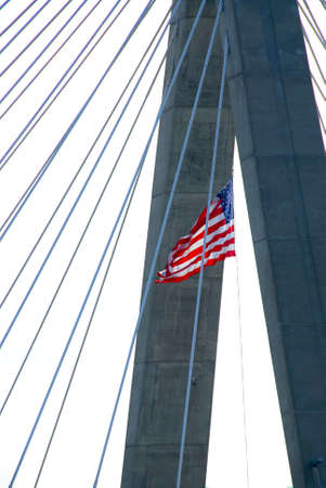 Detail of Leonard Zakim bridge in Boston with american flag