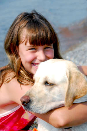 preteen girl: Portrait of a girl with a dog Stock Photo