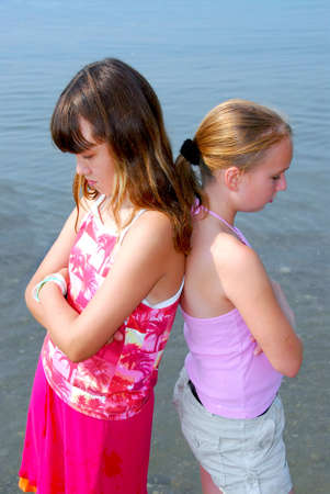 preteens beach: Portrait of two girls pouting