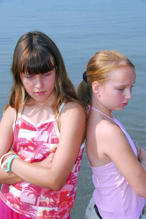 preteens beach: Two preteen girls pouting