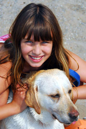 preteens beach: Portrait of a young girl with a dog Stock Photo