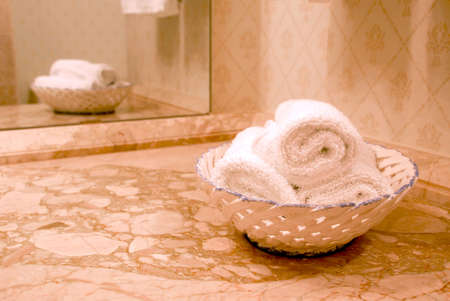 bathroom interior: Towels in luxury bathroom with beige marble counter Stock Photo