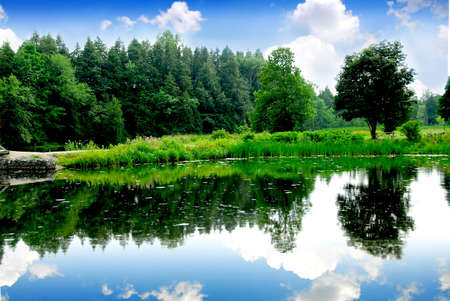 River landscape with sky reflection in water photo