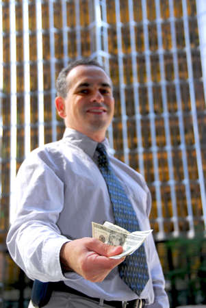 Businessman offering money Stock Photo - 496201