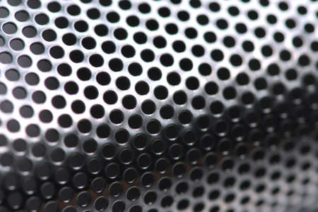 dof: Abstract background of perforated metal with very shallow dof