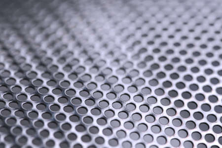perforated: Abstract background of perforated metal with very shallow dof
