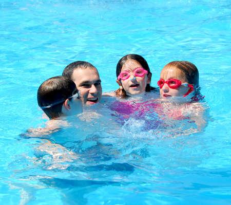 pool preteen: Family having fun in swimming pool