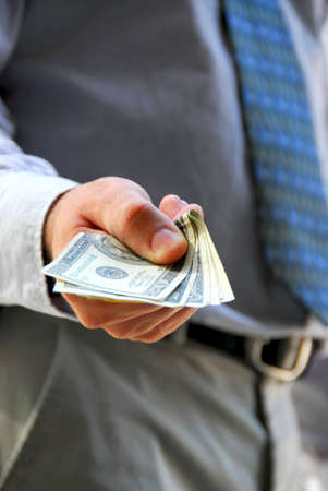 Hand of a businessman offering money Stock Photo - 502728