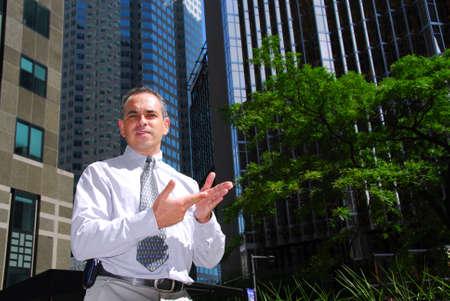 business pitch: Businessman explaining an idea downtown